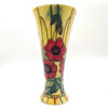 red vase with poppies