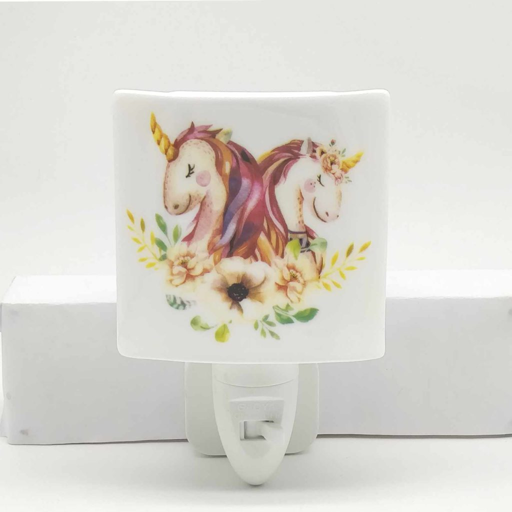 wall light with unicorn